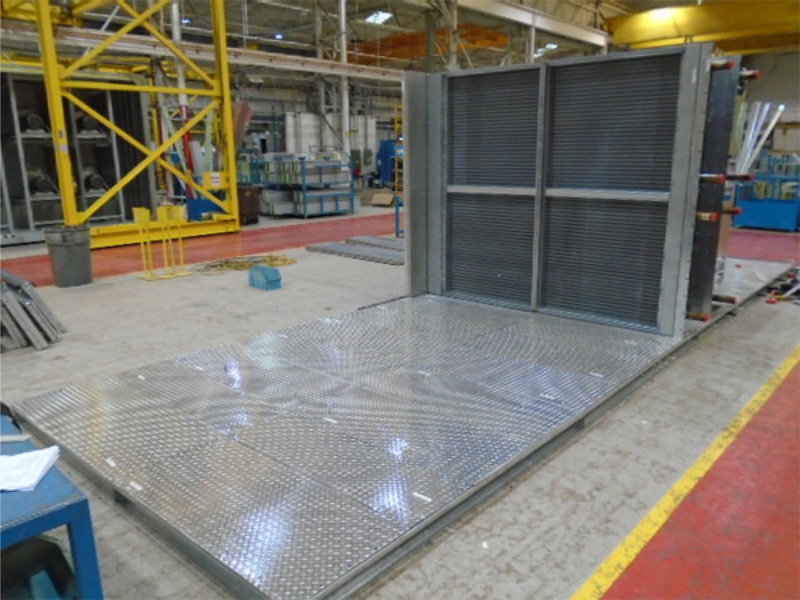 Completed ACCESS™ floor assembly with components being installed