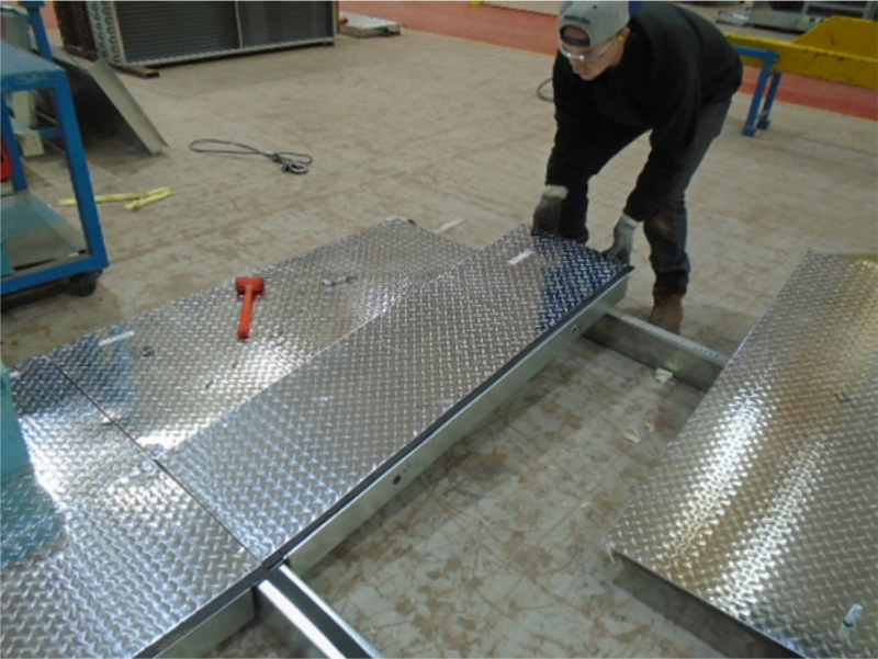 Installation of a floor panel on to the C-channel perimeter